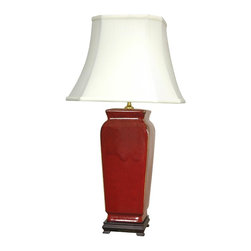 "Oriental Furniture - 25"" Oxblood Vase Porcelain Lamp - Illuminate your home with the handcrafted charm of our Oxblood Vase Oriental Lamp. Handcrafted by artisans in China's Guangdong province, this beautiful piece combines a Song dynasty style porcelain vase with a carved wooden base. The porcelain part of the lamp features a textured red glaze sure to add a colorful accent to any room. A fabric shade on a steel frame completes the design."
