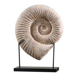 Uttermost - Kaleho Shell Sculpture - Keep the warm weather beach vibe alive and well, back at home and even in the darkest days of winter with this shell sculpture. The mesmerizing coiled pattern and sandy aura makes you almost hear the meditative sound of the surf.