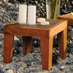 Hospitality Rattan - Panama Jack Leeward Islands End Table - Natural Teak with Viro Wicker Multicolor - Shop for Tables from Hayneedle.com! The Panama Jack Leeward Islands End Table - Natural Teak with Viro Wicker provides a rich accent to any patio setting. Every item in the Leeward Islands collection incorporates a high-grade Indonesian teak frame with a natural finish. Incorporating a unique combination of outdoor materials the Viro synthetic fiber comes in a beautiful dark finish. The end table is both weather- and UV-resistant for durable outdoor use. Teak will weather gracefully if untreated so maintenance with teak oil and light sanding is suggested (oil not included). Dimensions: 20L x 20W x 20H inches.About Hospitality RattanHospitality Rattan has been a leading manufacturer and distributor of contract quality rattan wicker and bamboo furnishings since 2000. The company's product lines have become dominant in the Casual Rattan Wicker and Outdoor Markets because of their quality construction variety and attractive design. Designed for buyers who appreciate upscale furniture with a tropical feel Hospitality Rattan offers a range of indoor and outdoor collections featuring all-aluminum frames woven with Viro or Rehau synthetic wicker fiber that will not fade or crack when subjected to the elements. Hospitality Rattan furniture is manufactured to hospitality specifications and quality standards which exceed the standards for residential use.Hospitality Rattan's Environmental CommitmentHospitality Rattan is continually looking for ways to limit their impact on the environment and is always trying to use the most environmentally friendly manufacturing techniques and materials possible. The company manufactures the highest quality furniture following sound and responsible environmental policies with minimal impact on natural resources. Hospitality Rattan is also committed to achieving environmental best practices throughout its activity whenever this is practical 