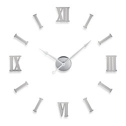 Cupecoy - DIY Metal Wall Clock w/ Roman Numerals - The latest trend in wall clocks lets you place the numbers wherever you want. (The hands will stay where you need them.) The Roman numerals of this clock are metal with adhesive backing, so you can place them in an orderly or creative fashion.
