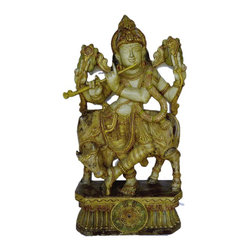 Wooden Krishna - Antique Finish - 3 Ft - This is the venugopala avatar of Krishna and Vishnu in the same form.  Krishna was a cow herder in hi syoung age. So a cows love for the lord has been depicted by she licking Krishna's feet.  The Lord is seen playing his favorite musical instrument- flute. This statue is carved by an artisan from southern part of India