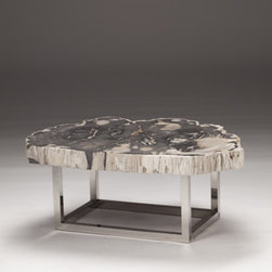 Stone Slice Table - Petrified stone tables are stunning, but perhaps they are better suited to a more formal living room.