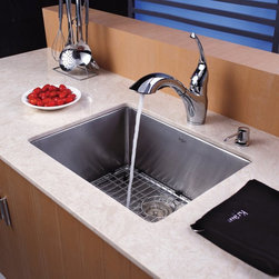 Kraus - Kraus KHU101-23-KPF2210-KSD30 Single Basin Undermount Kitchen Sink with Faucet - - Shop for Kitchen from Hayneedle.com! The flowing lines of the Kraus KHU101-23-KPF2210-KSD30 Single Basin Undermount Kitchen Sink with Faucet give your kitchen a contemporary elegance you will adore. Its faucet easily doubles as a strong sprayer while an integrated soap dispenser is always within reach. The stainless steel oversized basin offers plenty of room to take on any task.Product SpecificationsBowl Depth (inches): 10Weight (pounds): 26Low Lead Compliant: YesEco Friendly: YesMade in the USA: YesHandle Style: LeverValve Type: Ceramic DiscFlow Rate (GPM): 2.2Spout Height (inches): 7Spout Reach (inches): 9.3About KrausWhen you shop Kraus you'll find a unique selection of designer pieces including vessel sinks and faucet combinations. Kraus incorporates its distinguished style with superior functionality and affordability while maintaining highest standards of quality in its vast product line. The designers at Kraus are continuously researching and exploring broader markets seeking new trends and styles. Additionally durability and reliability are vital components at Kraus for developing high-quality fixtures. Every model undergoes rigorous testing and inspection prior to distribution with customer satisfaction in mind. Step into the Kraus world of plumbing perfection. With supreme quality and unique designs you will reinvent how you see your bathroom decor. Let your imagination become reality!