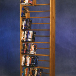 """Wood Shed - 700 Series 280 DVD Dowel Multimedia Storage Rack - This rack is truly a fine piece of furniture that will enhance your decor while providing easy access storage. This product looks great as it is solid wood and does not have any screws. Features: -Holds 385 CD's or 280 DVD's.-Distressed: No.-Collection: 700 Series.-Country of Manufacture: United States.-Commercial Use: Yes.-Material: Solid oak.-Solid Wood Construction : Yes.-Number of Items Included: 5 items: 1 rack, 2 feet & 2 sliders.-Scratch Resistant: Yes.-Heat Resistant: No.-Stain Resistant: Yes.-Drawers Included: No.-Exterior Shelves Included: Yes -Adjustable Exterior Shelves: No..-Cabinets Included: No.-Recycled Content: No.-Eco-Friendly: No.-Storage Capacity: 385 CD's or 280 DVD's.-Wall Mountable: No.Specifications: -ISTA 3A Certified: No.Dimensions: -Overall Height - Top to Bottom: 61.5"""".-Overall Width - Side to Side: 24.25"""".-Overall Depth - Front to Back: 7.25"""".-Drawer: No.-Shelving: -Shelf Height - Top to Bottom: 7.75"""".-Shelf Width - Side to Side: 22.75"""".-Shelf Depth - Front to Back: 6""""..-Overall Product Weight: 32 lbs.Assembly: -Assembly Required: No.Warranty: -Product Warranty: 6 months."""