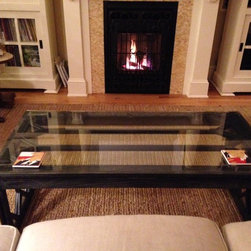 Salvaged Windows Coffee Table - This coffee table is made of two salvaged windows. The first was used as a table top, with a glass overlay. The second had any remaining glass removed from the panes and was cut in half in order to create the base.