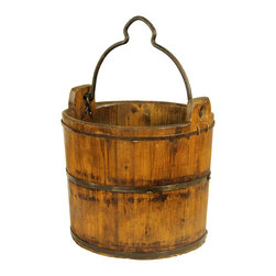 Antique Revival - Natural Vintage Wooden Farm Bucket - This vintage, wooden water bucket includes an iron handle and iron banding around the rim, middle and base for support. The natural, dark wood finish adds a country, rustic vibe to any room. The bucket looks great on its own, or can be used to display flowers. Each item is unique and one-of-a-kind and dimensions/features may slightly vary.