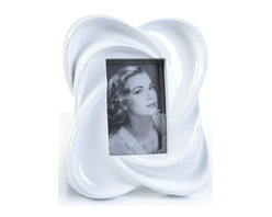 """Concepts Life - Concepts Life Photo Frame  Warm Embrace  4x6"""" - Looking to frame a memorable snapshot? Look no further than our warm embrace collection. This white frame with a beautiful glossy finish adds style to any mantle or table top. This quintessential frame for engagement and bridal photos is also an elegant gift for any housewarming.  Modern home accent Contemporary white picture frame Beautiful and elegant home accent Rectangular photo frame Made of polyresin Textured finish Easel back for horizontal or vertical display Various sizes available Holds 4 x 6 in. size photo Dimensions: 9""""w x 10""""h x 2""""d Weight: 2 lbs"""