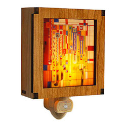 "Lightwave Laser - Frank Lloyd Wright Hardwood Saguaro Night Light - This stunning new Frank Lloyd Wright Saguaro hardwood night light has a built in light sensor to automatically turn on and off. In 1926-27 Liberty Magazine commissioned Frank Lloyd Wright to design a series of cover designs that the editors thought to be too ""radical"" and never used. In 1973 there was a fire in the Arizona Biltmore. The graphic was selected from the Frank Lloyd Wright Archive to be rendered in glass in the reconstructed foyer. Complete with a 7 watt night light bulb. Size: 4.25"" x 4""."