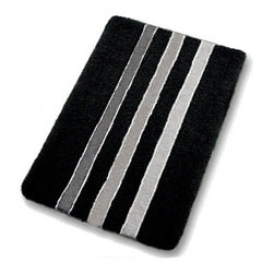 Black and White Bath Rug - Black and white bath rug design.  Rugs shown are a large size in our collection 23.6in x 39.4in ($89.99).  A densely woven pile that is 1in tall and machine washable. The black and white design is available in a contour / pedestal rug, small and two extra large sizes (27.6in x 47.2in and 31.5 x 55.1).