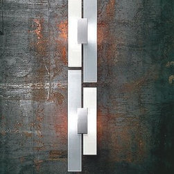 "ITRE - Avenue wall sconce - Product Details:   The Avenue wall sconce from ITRE has been designed by Ferrara and Masotti in 2006. This wall mounted luminaire is great for halogen lighting. The Avenue is constructed of satin white glass and silk screened diffusers. The body of the light is composed of chrome. The Avenue wall sconce features a brilliant and detailed design, along with quality craftsmanship, that is sure to beautifully illuminate any contemporary environment.  Details:                                              Manufacturer:                                           ITRE                                                              Designer:                                          Ferrara and Masotti                                                              Made in:                                          Italy                                                              Dimensions:                                           Height: 23 5/8"" (60 cm) Width: 6.75"" (17 cm)                                                              Light bulb:                                           1 X 150W halogen                                                              Material:                                           chrome, glass, silk-screen"