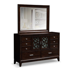 Espirit Dresser & Mirror - Enchanting Spirit. You're sure to fall under the spell cast by the rich wood and delicate, crackled glass of our phenomenal Esprit dresser and mirror. Finished in a deep merlot shade, this set features glass inlays with a shattered effect, each grouped in an arrangement that mimics the construction of stained glass. Double doors conceal a felt-lined jewelry drawer, perfect for organizing your rings and necklaces. Lovely extra touches, like the brightly polished chrome hardware, tapered wooden legs and beveled framing, enhance the captivating look of this dresser that helps create a truly otherworldly escape.