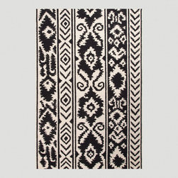 World Market - Black and White Lucine Flat-Woven Wool Rug - This black and white flat-woven wool rug adds a stylish tribal touch to any room. It is hand crafted of 100 percent wool and is durable, reversible and easy to care for.
