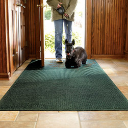 """Frontgate - WATER & DIRT SHIELD ™ 2'11""""W Entry Mat - Designed to capture the dampest, dirtiest tracks. 100% polypropylene (20% recycled content) fibers can absorb an entire gallon of water per square yard. Crush-resistant nubs remove and trap mud from feet. Raised rubber border ensnares every drop of water in each mat. Slip-resistant backing holds mat firmly in place. This WATER & DIRT SHIELD ™ Entry Mat absorbs water and scrapes mud from shoes and paws to keep your entryway clean and dry. Take your dog out in a downpour and walk back through the door without a worry. . . . . . Suitable for all floor types. Absorbs 1 gallon of water per square yard. Surface wash with mild detergent or rinse with a hose. Note: Do not place on wet floors. Made in USA."""
