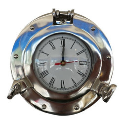 """Handcrafted Nautical Decor - Deluxe Class Chrome Porthole Clock 8'' - Nautical Wall Clock - Clock Decoration - The Chrome Deluxe Class Porthole Clock 8"""" is a classy and quality accent piece to add to any nautical themed room. This charming nautical port hole clock is both functional and stylish. Hand-painted a metallic chrome finish, this beautiful hanging clock will accent your nautical wall decor perfectly. In addition, this Chrome Deluxe Class porthole clock opens just as if it were on a ship of the time. Batteries not included."""