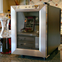 Vinotemp - Vinotemp VT-6TEDS 6 Bottle Wine Cooler - VT-6TEDS - Shop for Wine Refrigerators from Hayneedle.com! This compact 6-bottle cooler can be placed on a table top or be free-standing to keep your wine at just the right temperature. It features a black cabinet with stainless steel door trim and handle with a sturdy wire shelf racking system for individual bottle storage. Because of its thermo-electric cooling system which involves very few moving parts this unit ensures that your wine will be protected from unnecessary vibration. Thermo-electric cooling is not only good for your valuable wine collection but also for the environment. Using absolutely no ozone-depleting chemicals such as CFCs or HCFCs you will be sure that you are doing your part to preserve the environment. The VT-6TEDS uses dual paned glass windows a technology that has been proven in the construction industry. They have better insulation properties better UV protection and are easier to clean. This energy efficiency will lead to less electricity usage and savings in energy bills throughout the years. About VinotempBased in Southern California since 1985 Vinotemp has proudly crafted custom built wine coolers for some of the finest restaurants and homes in the world. They've sold over 250 000 beautiful wine cellars in the United States and overseas. With a focus on quality value and service first implemented by founder Francis Ravel Vinotemp continues the tradition of creating innovative storage solutions for your fine wine.
