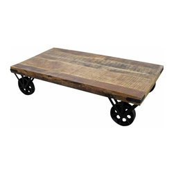 Industrial Iron and Wood Coffee Table - A coffee table made with wood and iron would work well with the industrial theme. This one has a reclaimed wood top and heavy iron wheels. The price seems decent, but I can't help but think you could make something like this yourself.
