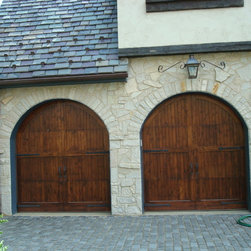 P-0060 - Knotty Alder stained doors on a Tutor style home, Contrast between Stone and dark stained wood