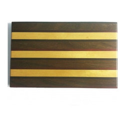 "Exotic Chopping Blocks - 8"" x 12"" Cutting Board - This design was created for those with a colorful eye looking for a subtle touch. With the way this board varies in think and thin pieces, the nuances of this board bring the colors to life. The woods used in this board include yellow heart and Padouk from South America and Ebony from Africa. All the woods are their natural colors. There has been no paint or stain added."