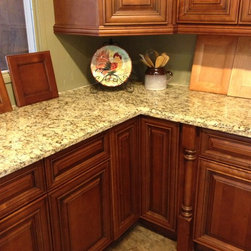 Granite 101 - Here is a Venetian Gold Group 1 Granite on a Deleware Ginger production cabinet. This is getting bang for your buck at it's finest. A nice, traditional look with high quality materials built to last for the best value.