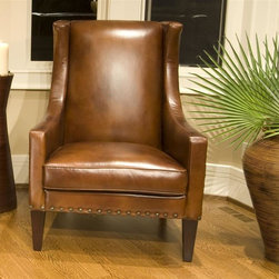 Elements Home Furnishing - Bristol Top Grain Leather Accent Chair in Rus - Shown in Rustic. Top Grain Leather. Curved track arm. Antiqued brass nailhead accents along sides and base. Tight back cushion. Hardwood frame encased in high density foam. Dark brown wood feet. Dimensions: 35 in. D x 37 in. W x 47 in. H ( 79.2 lbs. )The Bristol Chair offers a sleek and attractive addition to the space of your choice.  This chair has a well-defined curve in the arms and a tight-fit high density cushion back for additional support.  The slender long legs have an espresso wood finish for contrast with the top grain leather shown in Rustic.  Decorative honeycomb textured nailheads border the silhouette of the frame.  This classic design is practical and will compliment any decor.