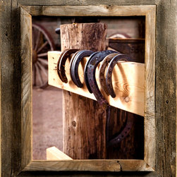 MyBarnwoodFrames - 4x4 Cowboy Picture Frames, 2.5 inch Wide, Western Rustic Series - Cowboy  Picture  Frames                     Cowboy  Picture  Frames  are  some  of  our  favorites  to  create.  Our  western  decor  enthusiasts  have  an  appreciation  for  barnwood  that  city  folk  just  can't  always  understand.  To  them,  barnwood  just  looks  old,  but  a  more  practiced  eye  can  detect  subtle  color  variations  and  rich  textures.  Of  course,  you  can  appreciate  nature  in  a  way  that  those  who  only  view  fields  of  sagebrush  from  inside  their  air-conditioned  cars  can't.  They don't  see  the  wildflowers,  the  scorpions  and  the  circling  hawks  either.                               Maybe  you  can't  dismantle  the  weathered  barn  and  bring  it  indoors,  but  you  can  give  prominence  to  some  of  that  beautiful  rustic  wood  with  one  of  our  Western  Rustic  frames. Our  cowboy  picture  frames  case  a  ¾  inch  plank  edge  inside  a  1-½  inch  rustic  wood  frame.  The total  frame width  is  approxmately  2.25  inches  (frame  widths  sometimes  vary  depending  on  the  width  of  the  original  barnwood  plank). This  frame-inside-frame  look  lends  itself  especially  well  to  western  rustic  subject  matter. Your  frame  includes  glass,  foam  board  backing  and  hardware  for  hanging.              Here's  the  perfect  cowboy  picture  frame  for  that  photo  of  your  daughter  on  her  first  pony  ride,  a  sunset  on  the  ranch,  or  a  painting  of  flowering  cactus.  The  unique  casing  also  makes  these  rustic  western  frames  a  great  choice  if  you  want  to  create  a  shadowbox  for  your  grandfather's  bolo  tie  clasp,  a  lucky  horseshoe,  or  a  few  dried  wildflowers. This  style  looks  great  when  paired  with  one  of  our  collage  frames.   This  is  authentic western  rustic decor  at  its  best.                Click  here  to  view  our  entire  inventory  of  Western  and  Cowboy  Frames           Product  Specifications:                                         Frame  is  crafted  from  authentic  barnwood                                        Frame  width:   2.25  inches                                        4x4  photo  opening                                      Glass  is  included                                      Sawtooth  hanger                             Please  note:   Due  to  the  nature  of  barnwood,  your  cowboy  picture  frame  may  vary  slightly  in  color  and  texture  from  the  one  pictured  here. Photos  are NOT  included.