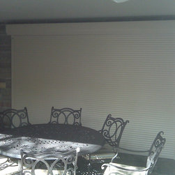 Shutter on Glass Door - Rollshutter installed on glass patio door to provide security and weather protection.