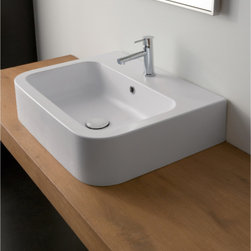 """Scarabeo - Fashionable Contemporary White Ceramic Rectangular Vessel Sink - Designed and manufactured in Italy by Scarabeo, this fashionable curved rectangular sink is made of high quality white ceramic. Beautiful contemporary above counter vessel sink includes overflow and the option for a single faucet hole (as shown) or 3 holes. Sink dimensions: 23.60"""" (width), 4.30"""" (height), 18.00"""" (depth)"""