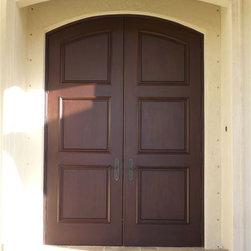 "Elliptical Double Entry Doors - Elliptical double entry doors 9'-4"" height made out of solid mahogany wood with 3 panels on each door slab pre-hung with custom 9"" jambs, brick mold, t-astragal and casing finished in a dark brown finish color for a newly-constructed custom home in Doral, Florida."