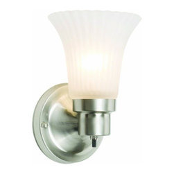 DHI-Corp - The Village 1-Light Wall Sconce, Satin Nickel - The Design House 504977 The Village 1-Light Wall Sconce has a sleek finish to illuminate your home. Constructed of formed steel and finished in satin nickel, the frosted opal glass and curved construction will add a touch of style to any room. This fixture uses (1) 60-watt medium base incandescent bulb. With a versatile design, this fixture can easily be paired with vintage or modern furnishings. This sconce's petite design mounts seamlessly to the wall without a chain or visible wires. Measuring 8.25-inches (H) by 5.1-inches (W), this 1.2-pound wall mount can be mounted facing up or down depending on location and preference. This wall mount is UL listed, UL approved for damp areas and is rated for 120-volts. Coordinate your home with the rest of the Village collection which features a beautiful matching pendant, chandelier, vanity and ceiling mount. The Design House 504977 The Village 1-Light Wall Sconce comes with a 10-year limited warranty that protects against defects in materials and workmanship. Design House offers products in multiple home decor Categories including lighting, ceiling fans, hardware and plumbing products. With years of hands-on experience, Design House understands every aspect of the home decor industry, and devotes itself to providing quality products across the home decor spectrum. Providing value to their customers, Design House uses industry leading merchandising solutions and innovative programs. Design House is committed to providing high quality products for your home improvement projects.