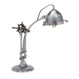 Gearhead Lamp - Slick chrome and cool industrial touches make this table lamp a sleek, handsome choice in modern settings. Enjoy its stylish form as an unexpected addition to your living room or office. We recommend an Edison bulb as the finishing touch.