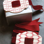 """Red Letterpress Buckle with Velvet Ribbon - I am woefully unskilled at tying a decent bow, so this charming gift """"buckle"""" could save me from giving an unkempt present this holiday season. It comes with a yard of velvet ribbon that can easily be pulled through and cut to size. No extra finger or fancy looping skills required!"""