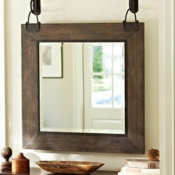 "Carlton Round Wood Mirror, 40 x 48"" - Because of the handcraftsmanship visible in the frame's distressed finish and the carefully rubbed scrolled hooks, each of our Carleton Mirrors is one of a kind. 40"" wide x 48.75"" high x 4.25"" deep MDF frame with wood veneer. Distressed gray stained finish. Iron hardware with a bronze finish. Beveled glass mirror. Mounting hardware included. Catalog / Internet only."