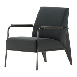 Vitra - Fauteuil De Salon Armchair by Vitra - A 1930s classic updated for modern tastes. The Vitra Fauteuil De Salon Armchair was rediscovered in the archives of designer Jean Prouve and has been released in an updated contemporary color palette. The design is signature Prouve: angular planes of sheet steel together with tubular steel, supporting similarly angled cushions and solid oiled wood armrests. Founded in Switzerland in 1950, Vitra produces intelligent and inspiring furniture and accessories for the home, office and other public spaces. Ever mindful of the importance of sustainability in design, Vitra creates furnishings with high quality and versatile style that ensures functional and aesthetic enjoyment for the long term.