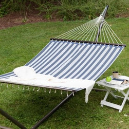 Island Bay 13 ft. Quick Dry Poolside Navy Stripes Hammock with Steel Stand - Additional features: Stand dimensions: 13 - 15 ft. L x 4 ft. W x 3 ft. 9 in. H Hardwood spreader bars in rich, dark finish Hanging distance min/max: 13 ft./16 ft. Hanging hardware included With the Island Bay Quick Dry Poolside Navy Stripes Hammock with Stand,, you make the perfect spot to enjoy an afternoon siesta or get yourself that perfect tan. You'll love how its classic nautical look with blue and white stripes brings a whiff of the sea right to your backyard. And when it comes to comfort, this hammock has no equals! Made of weather-resistant, quick dry polyester fabric, this hammock will take relaxation to a whole new level; so much so that you might be tempted to spend every waking hour outdoors! Featuring an extra wide bed, this hammock has hardwood spreader bars designed to hold it open for easy getting in and out. Perfect for two adults, this hammock has a weight capacity of 450 pounds. The dimensions of the bed itself are 6 feet 5 inches in length and 4 feet 5 inches in width. Powder-coated for weather- and rust-resistance, the heavy-duty 14-gauge steel stand comes in a choice of finishes, so you can make the perfect look for your new favorite napping spot. The whole package assembles in about 10 minutes with no need for tools. One of our most beloved hammocks, the Island Bay Quick Dry Poolside Navy Stripes Hammock has constantly topped our customer favorite list. Taking a cue from that, we've paired this hammock with our sturdiest, most trusted hammock stand, so you can enjoy your new hammock immediately and start making the most of summer! About Island Bay HammocksIsland Bay Hammocks come to you directly from skilled hammock artisans, and feature the Island Bay logo on the spreader bar. Using the latest technology alongside time-tested traditional methods of construction, these hammocks are woven with the pride of their makers.