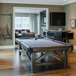 Custom Pool Tables - a custom steel and claro walnut pool table with a custom cue and accessory rack