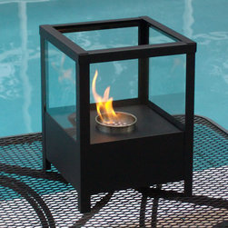 Sparo Tabletop Bio Ethanol Fireplace by Nu-Flame - Sparo, lantern-like in appearance, is ideal for creating emotional decor. Providing a 360 degree view of the dancing flame, Sparo provides comforting warmth in a small space or patio. This fireplace offers an eco-friendly flame that is odorless. Bio Ethanol, an alternative fuel source produced from plants, only emits water vapor and carbon dioxide into the air. Although ethanol fireplaces aren't intended for use as a primary heat source, the Sparo model produces some heat that will change the ambient temperature in a small space. For aesthetic appeal and safety, this fireplace includes four panes of tempered glass that surround the flame and provide the unobstructed view. Appropriate for any space, indoors or out, Sparo's base is offered in a black powder-coat.