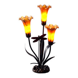 River of Goods - 21 Inch High Handblown Three Amber Lily and Dragonfly Accent Lamp - Lily lamps are a great way to add a touch of ambience to any room, large or small. They make great gifts for the holiday's and special occasions. The shades are made of molten glass that is hand blown and shaped. This lamp has three shades that are crated using milk glass. They are mocha and amber with striated swirls. The base is bronze toned and fashioned into lily leaves and has a stained glass dragonfly dancing the midst.   Requires three 15W bulbs (not included).  UL approved.  2 prong plug.