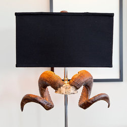 Bighorn Lamp - Our Bighorn Lamp, with its black rectangular shade and a resin-cast, ramhorn-adorned base, is like a cowboy in Manhattan — arrestingly sexy. With rustic charm and polished nickel detailing, it's a perfect piece for the cosmopolitan that's wild at heart.