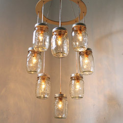 Mason Jar Chandelier by Boots N Gus - Mason jars make for vintage-inspired lighting that adds a soft glow to any room.