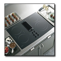 "GE Profile - PP989DNBB 30"" Smoothtop Electric Downdraft Cooktop with 400 CFM  3-Speed Fan  4 - The GE PP989DNBB 30 in smooth surface downdraft electric cooktop accommodates various size pots or pans It features ribbon heating elements a frameless ceramic glass cooktop and a 69 PowerBoil element This efficient cooktop has a powerful downdraft e..."