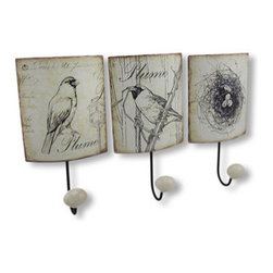 Set of 3 Distressed Metal Bird Themed Wall Hooks - This set of metal wall hooks adds a decorative accent to any wall in your home or office. Each hook features a black and white bird theme, with artificially distressed, shabby chic edges, black enamel coated hooks and white resin knobs. Each hook measures 8 1/4 inches long, 4 1/4 inches wide, 2 inches deep, and easily mounts to the wall with a single nail or screw by the keyhole hanger on the back. These hooks are great for hanging coats, hats, bags, or leashes, and they make a lovely housewarming gift.