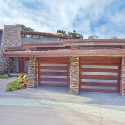 Del Mar Custom Garage Doors - Here we worked with the homeowner, architect and builder to achieve the desired look for this fabulous home, which was selected as a Winner of Home of the Year by San Diego Home and Garden Magazine.  The door was constructed of African Mahogany with Opti-White Glass.