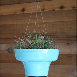 HangPot, Turquoise Wallter - I love the turquoise hue and cool midcentury lines of this hanging planter from Horne. It would look fantastic holding succulents or air plants, and the built-in drainage and drip catcher means it can be used indoors or out.