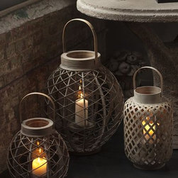 Lanterns with Glass hurricane - These lanterns have a wonderful variety of weaving that actually look best together. Grouped together on a side or dinner table outside, they would provide all the light you need for an outdoor summer dinner party.