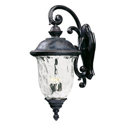Maxim Lighting - Maxim Lighting Carriage House VX Traditional Outdoor Wall Sconce X-BOGW89404 - Experience the likes of a Bifrost cold snap without Thor's tomfoolery with this Traditional Outdoor Wall Sconce. The water glass stuns with its enchanting sparkle and the highly detailed antique styling, which makes this an elegant ornament on your porch or patio. The Oriental bronze finish provides an excellent seal reminiscent of Norse armor.