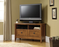 "Sauder - August Hill 40"" TV Stand - Inspired by antiques and heirlooms, the arts and crafts influenced design of August Hill is like finding a reassured piece from historic home, magically updated to serve today's changing needs and lifestyles. The warm Oiled Oak finish plays well with any home decor and existing woodwork, enabling August Hill to blend in or stand alone as an accent. Features: -Holds TV weighing 95 lbs.-Divided shelving holds audio and video equipments.-Hidden storage behind simulated drawer fronts and doors.-Oiled Oak finish.-August Hill collection.-Recommended TV Type: Flat.-TV Size Accommodated: 40"".-Finish: Oiled Oak.-Powder Coated Finish: No.-Gloss Finish: No.-Material: Engineered wood.-Solid Wood Construction: No.-Distressed: No.-Exterior Shelves: Yes.-Drawers: No.-Cabinets: Yes -Number of Cabinets: 2.-Number of Doors: 2.-Door Attachment Detail: Hinges.-Interchangeable Panels: No.-Magnetic Door Catches: Yes.-Cabinet Handle Design: Pulls.-Adjustable Interior Shelves: Yes..-Scratch Resistant: No.-Removable Back Panel: No.-Casters: No.-Accommodates Fireplace: No.-Lighted: No.-Media Player Storage: Yes.-Media Storage: Yes.-Cable Management: Cable hole.-Remote Control Included: No.-Weight Capacity: 95 lbs.-Swatch Available: Yes.-Commercial Use: No.-Collection: August Hill.-Eco-Friendly: Yes.-Recycled Content: No.-Lift Mechanism: No.-Expandable: No.-TV Swivel Base: No.-Integrated Flat Screen Mount: No.-Non-Toxic: Yes.-Product Care: Wipe with a damp cloth.-Country of Manufacture: United States.Specifications: -ISTA 3A Certified: Yes.-CARB 2 Certified: Yes.-CARB Certified: Yes.-FSC Certified: Yes.-General Conformity Certified: Yes.-EPP Certified: Yes.Dimensions: -Overall Height - Top to Bottom: 23.622"".-Overall Width - Side to Side: 39.291"".-Overall Depth - Front to Back: 19.528"".-Drawer: No.-Shelving: -Shelf Height - Top to Bottom: 5.875"".-Shelf Width - Side to Side: 17.375""..-Cabinet: Yes.-Legs: Yes.-Overall Product Weight: 63 lbs.Assembly: -Assembly Required: Yes.-Tools Needed: Phillips screwdriver and hammer.-Additional Parts Required: No.Warranty: -Manufacturer provides 5 year warranty.-Product Warranty: 5 Years."