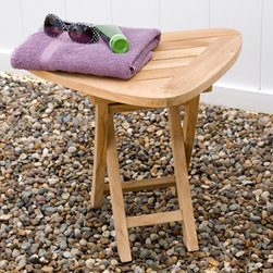 Jakie Teak Folding Triangular Outdoor Seat - Made of teak wood, the Jakie Triangular Outdoor Seat folds easily for trips to the beach or other outdoor activities. Left unsealed, it can be easily finished if desired. Also makes a great side table.