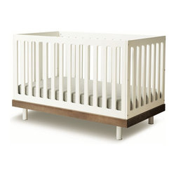 "Oeuf - Classic Crib by Oeuf, Walnut - 3 adjustable mattress positions in US, Canada & Europe; 2 adjustable mattress positions in Australia. Adjustable Legs. Fits a standard 28""W x 52""L crib mattress (not included). Mattress must be at least 27.25""W x 51.625 ""L and 4-6"" thick. Changing pad is included with station but the cover not included. Assembly required."