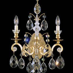 Schonbek - Renaissance New Heirloom Gold Two-Light Clear Heritage Handcut Crystal Wall Scon - -Heritage Handcut Crystal: This crystal is cut by hand in two stages on an iron and then a sandstone wheel. Each crystal is then polished on a wood wheel with marble dust. The most authentic handcrafted crystal in the world.  - This baroque style of chandelier dates back to the court of King Louis XIV in the seventeenth century. Schonbek's bold mix of crystal trims and finishes adds a flavor of twenty-first century eclecticism. Also Made with Swarovski Elements.  -Clear Heritage Handcut  - Light Source: Incandescent Bulb  - Bulbs not included  - Uses standard line volt dimmer  - Some assembly required  - For shipping outside of USA, please contact Bellacor customer service  - Cleaning and Care Instructions: Every Schonbek product is of heirloom quality and will last for generations. To ensure it retains its brilliance and splendor for years to come, proper care and regular cleaning are necessary. It is recommended that Schonbek products, and particularly their crystal trim, be lightly dusted with a feather or lambswool duster, or soft brush every two months, or whenever it appears dull or dusty. Consult the fixtures trim diagram for detailed cleaning instructions list of approved cleaning solutions. Schonbeck fixtures should never be subjected to any chemical cleaning agents. - See packaging insert for warranty information. Schonbek  - 3761-22