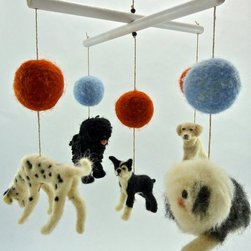 Black and White Multibreed Dog Mobile by Sheep Creek Needlecraft - The second thing I bought for my daughter's nursery was a customized felt dog mobile from the talented Sheep Creek Needlecraft Etsy shop. Miniature felt versions of our chihuahua and bully calm the little one whenever we put her down.